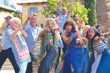 """(L to R, center) Rosie (JULIE WALTERS), Sam (PIERCE BROSNAN), Sophie (AMANDA SEYFRIED) and Tanya (CHRISTINE BARANSKI) in """"Mamma Mia! Here We Go Again."""" Ten years after """"Mamma Mia! The Movie,"""" you are invited to return to the magical Greek island of Kalokairi in an all-new original musical based on the songs of ABBA."""